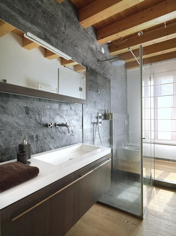 Bathroom with stone and wood finishes.