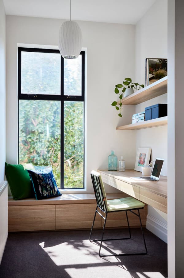 Contemporary home office full of sunlight and with minimal furniture.