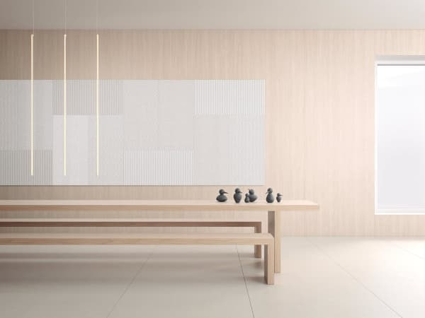 A minimal room with acoustic panels used in place of a big artwork, a proof that silence is becoming an interior design trend.