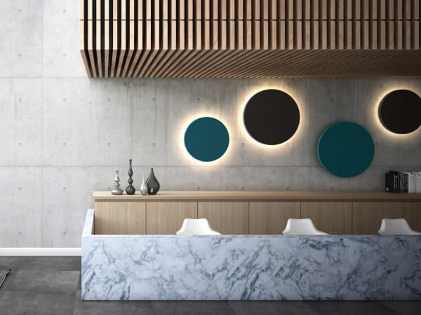 Contemporary room with round colorful acoustic panels with integrated backlight used as art.