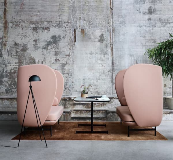 Acoustic pink chairs with a high and enveloping back.