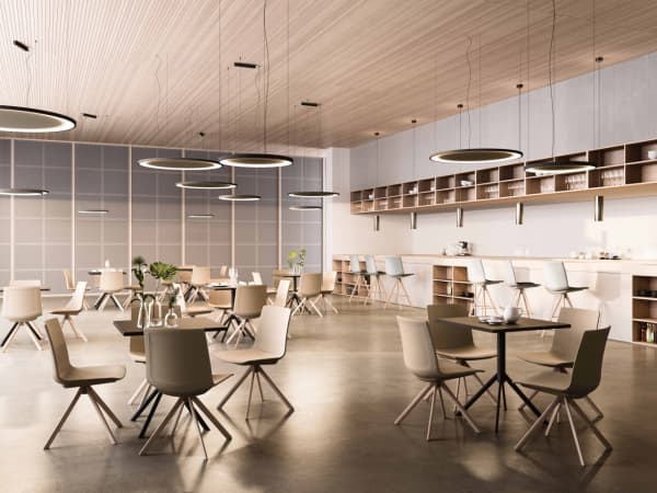 Office canteen area furnished with sound insulating tables.