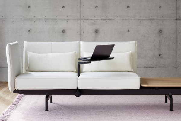 Sofa with integrated small desk.