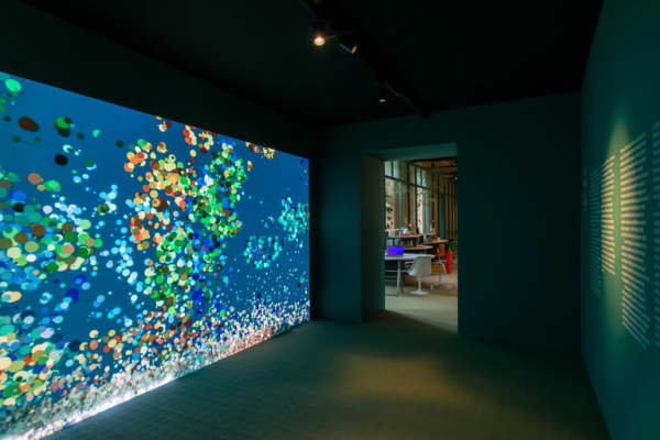 An interactive wall translating passing people into moving dots.