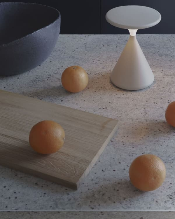Portable table lamp on a kitchen countertop.