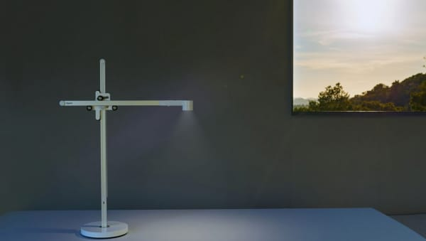 Table lamp that adjusts to the external conditions.