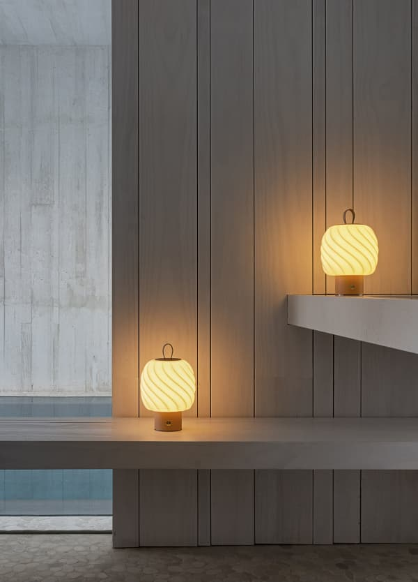 Portable table lamps with porcelain shade shaped in the form of a fluffy ice cream.