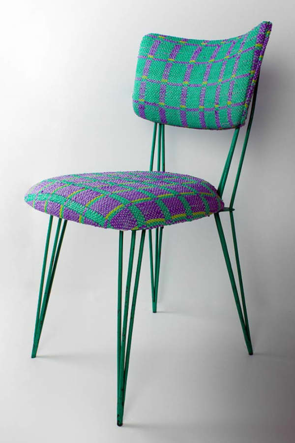 Metal chair with seat upholstered with Plastex, a sustainable material made recycling plastic bags.