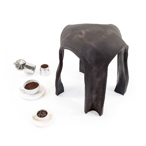 Circular stool made out of coffee grounds.