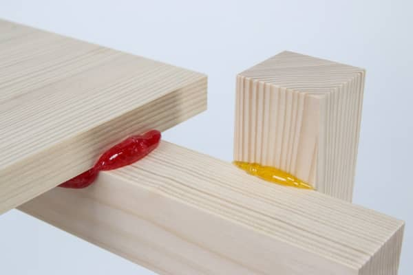 Close up of the wooden pieces kept together with a candy-based glue.