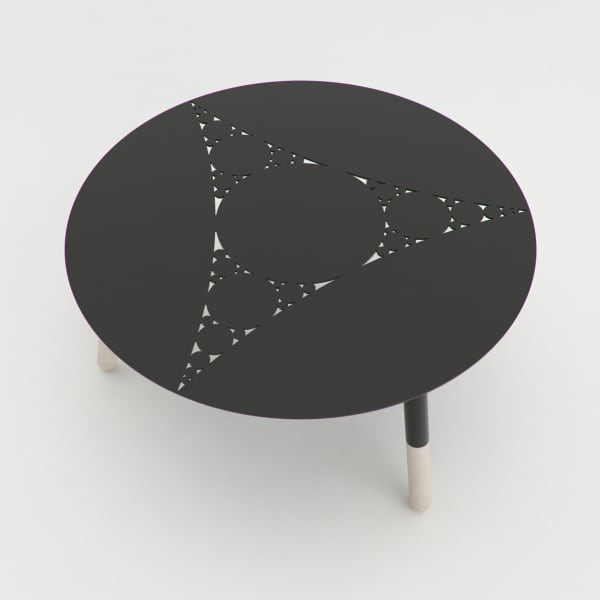 Minimal coffee table with a fractal pattern cut on the metal top.