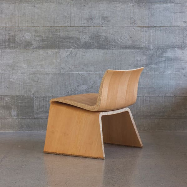 Organic shape chair that looks like a regular bent-wood chair but it's actually an example of biofabriction.