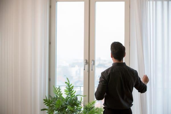 IKEA GUNRID white curtains on a large window.