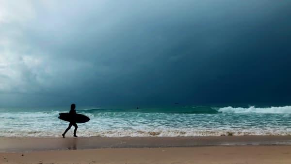 A surfer on the beach.