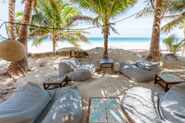 The outdoor lounging area of Casa Nalum sits directly on the beach.