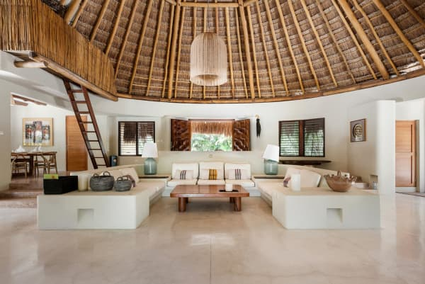 Living area of Casa Nalum, with straw hut roof.