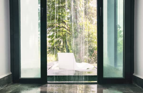 The pool's access to a rainfall walk-in shower.