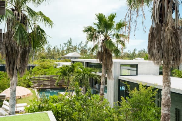 Helicopter view of Villa Islander, a biophilic design home immersed in the forest.