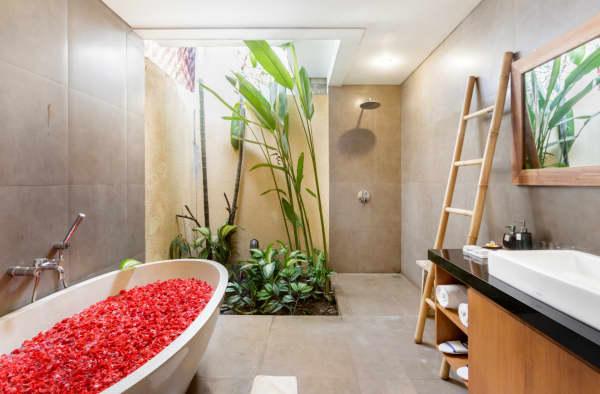 Biophilic bathroom with a greenery corner.