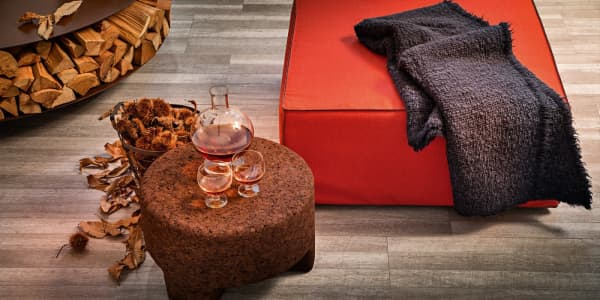 Dark cork ottoman, perfect for a biophilic outdoor.