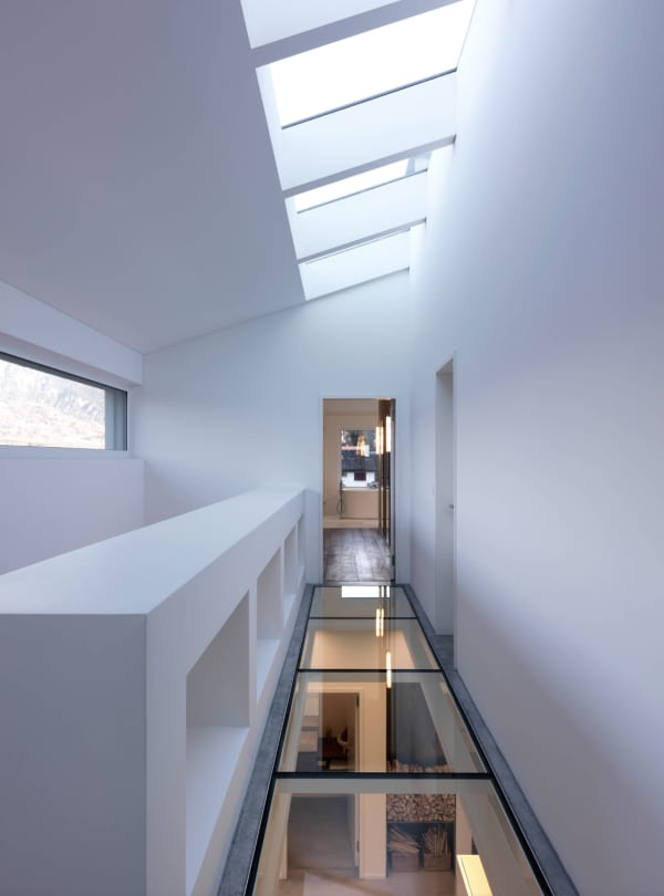 A corridor with clear glass flooring.