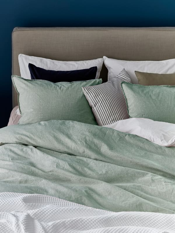 Bed with organic cotton sheets.