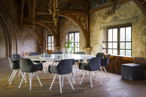 Round table with chairs designed with circular principles in mind.
