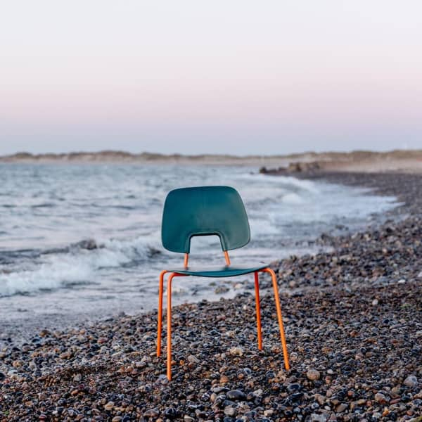 Chair made with fishing net and recycled steel.