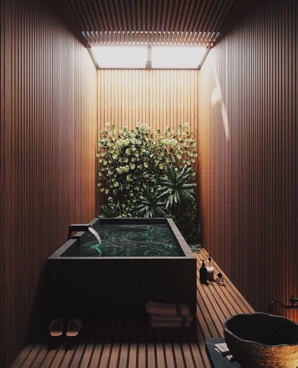 Cozy wooden bathtub area.