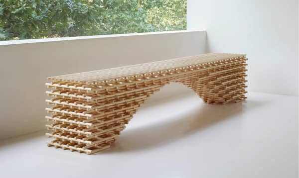 A bench made of interlocked wooden dowels.