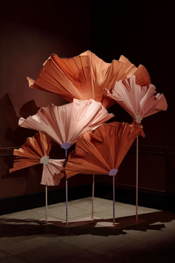 Flower-shaped screen with a wooden dowel as stem and leftover fabric as petals.