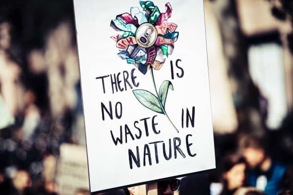 "Climate change sign saying ""There is no waste in nature""."