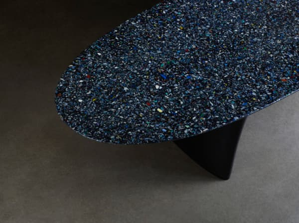 Close-up of the bench top texture made using ocean plastic fragments.
