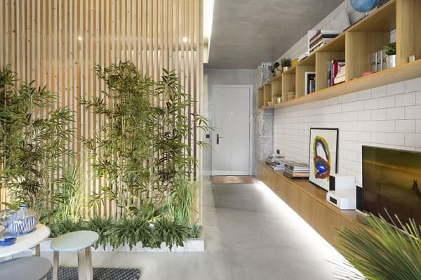 Partition wall made of wood pillars and plants to add coverage.