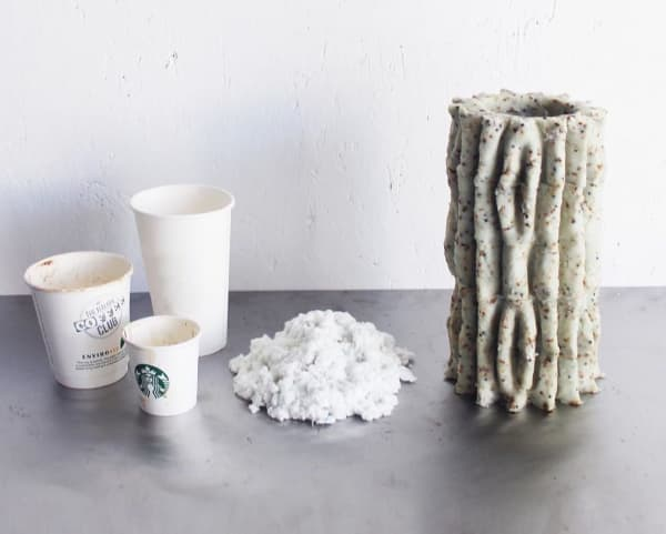 Trashed coffee cups next to a mycelium based vase.