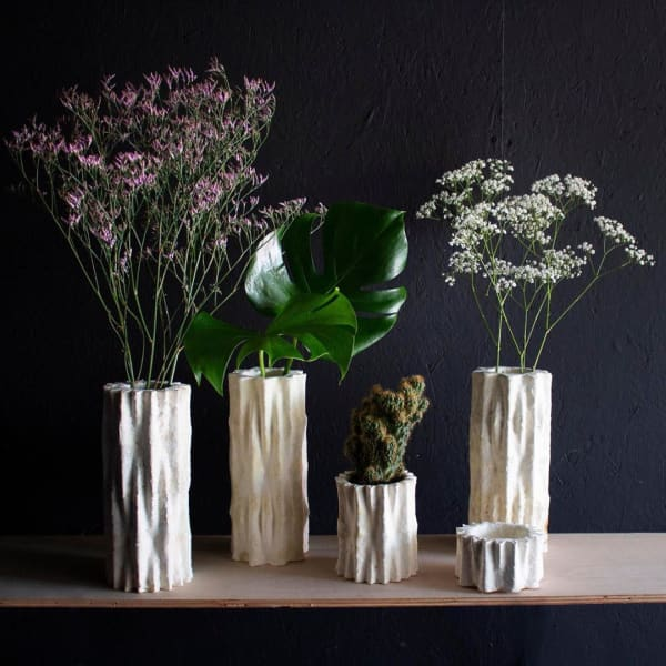 Vases with several shapes all made of mycelium.