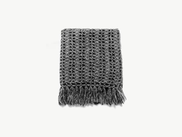 Dark grey crocheted blanket.