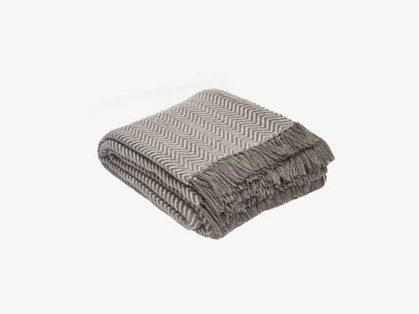 Taupe blanket with a herringbone pattern.