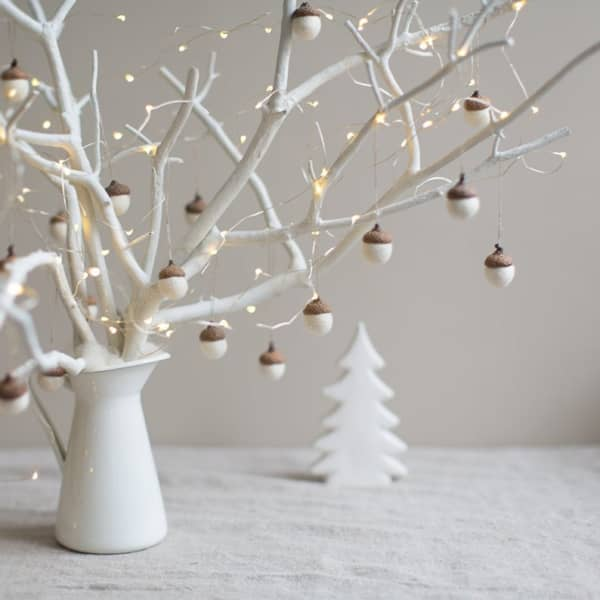 Branch decorated with acorns with a felt body mounted on real tops.