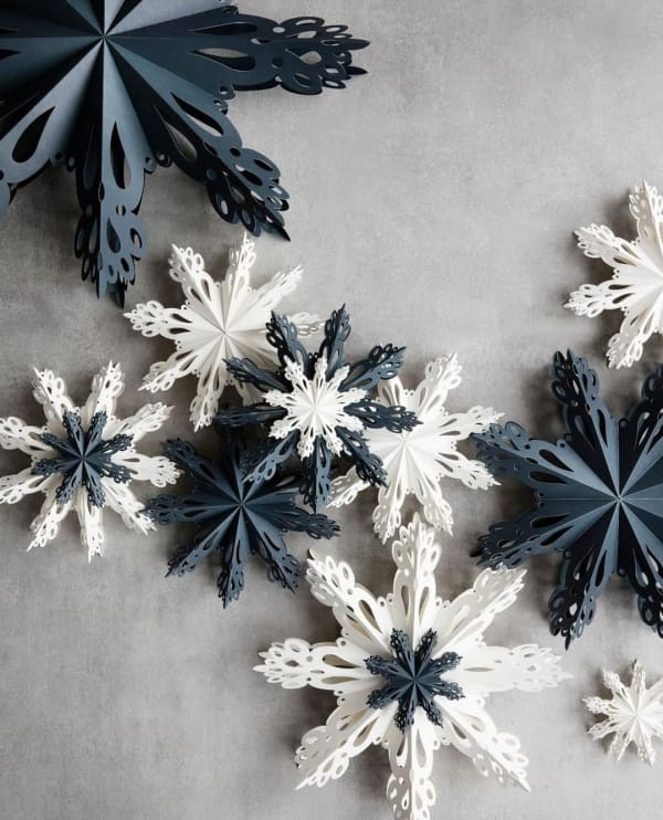 Flatlay of blue and white paper stars.