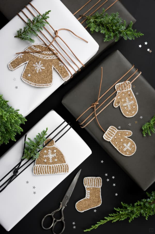 White and black paper decorated with cork ornaments.