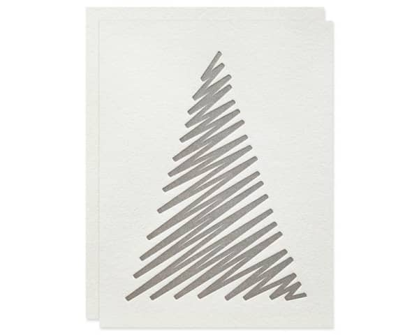 White Christmas card decorated with a simple drawn tree.