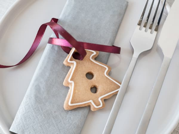 A biscuit tied around a napkin with a satin ribbon.