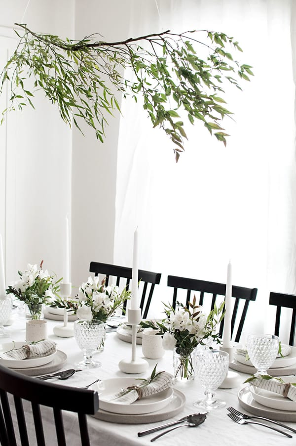 Olive branch hung over a dining table.