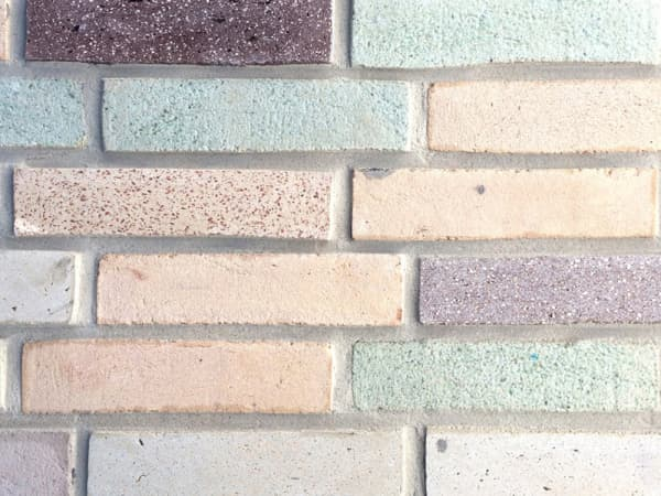 A wall of colourful and sustainable bricks.