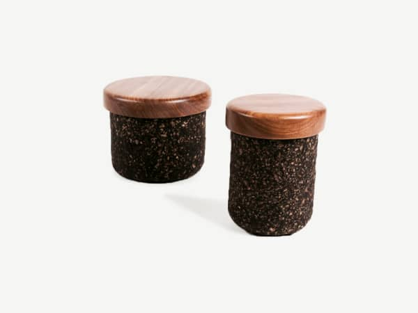 Containers with a wooden cap and the body made of coffee grounds.