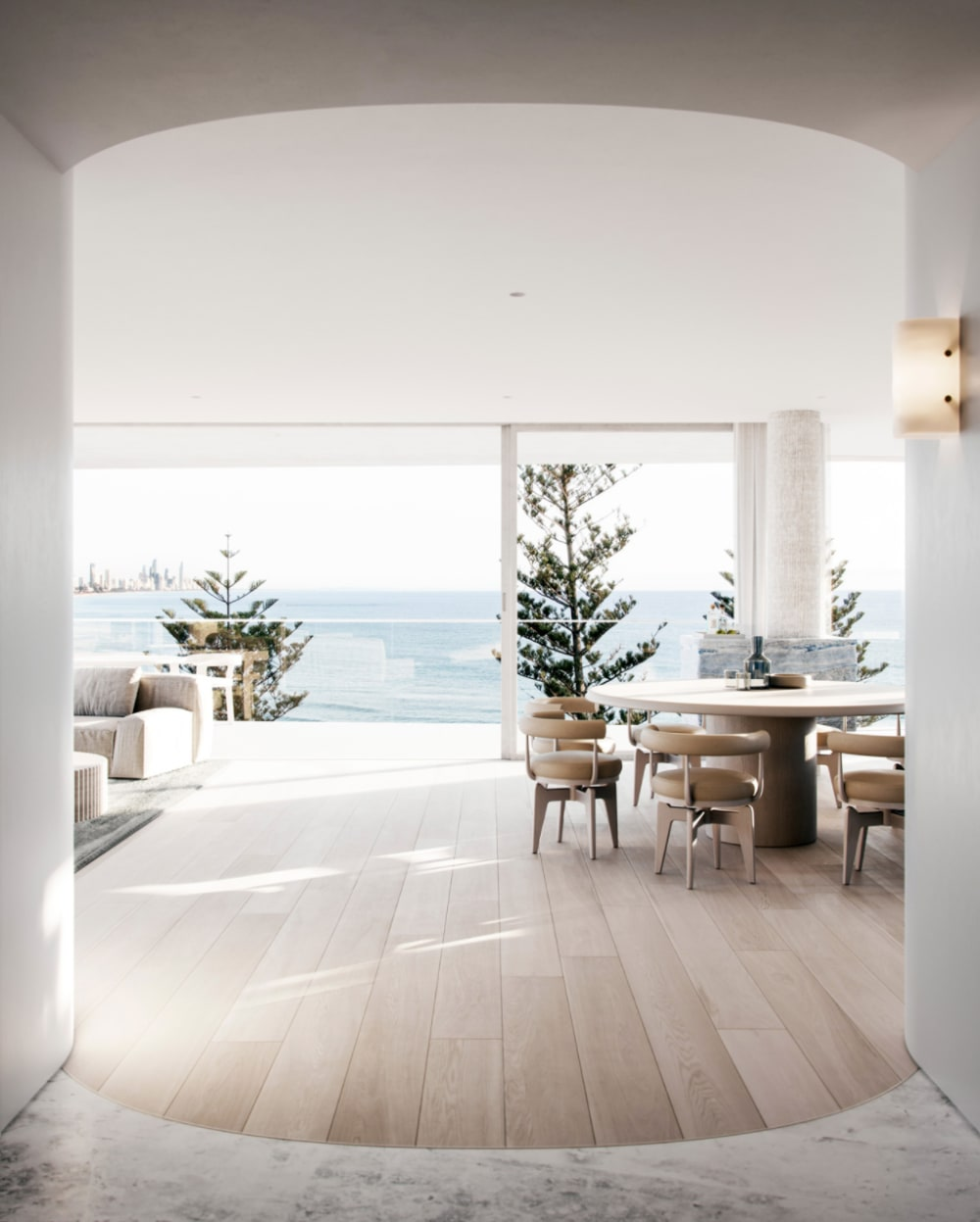 """Contemporary living room with full-height windows looking into the ocean.<span class=""""sr-only""""> (opened in a new window/tab)</span>"""
