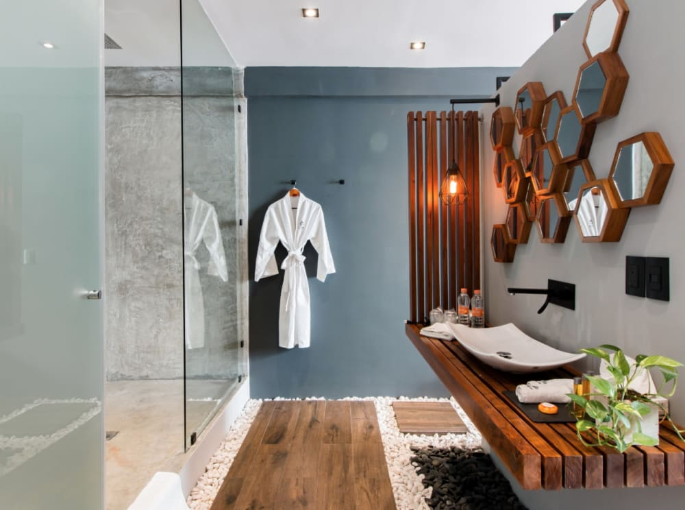 """Ensuite bathroom: view of the pebble and wood floor.<span class=""""sr-only""""> (opened in a new window/tab)</span>"""