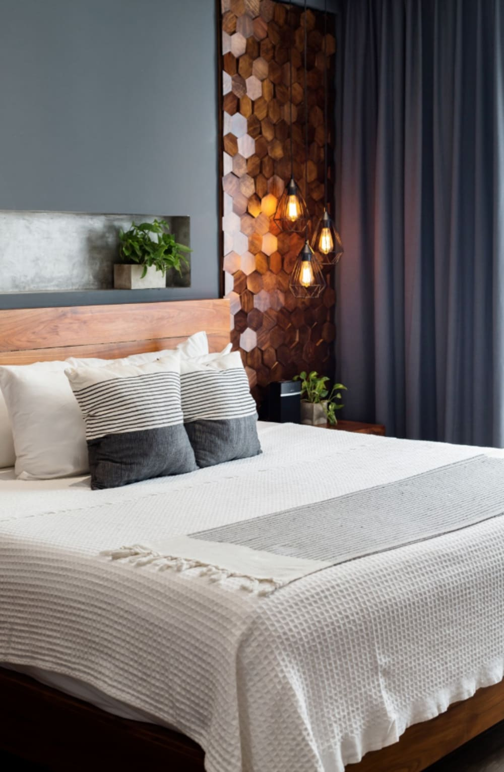 """Close-up view of the feature wall behind the bed.<span class=""""sr-only""""> (opened in a new window/tab)</span>"""