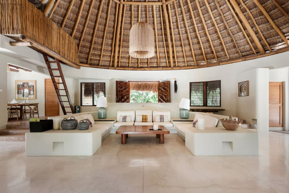 """Living area of Casa Nalum, with straw hut roof.<span class=""""sr-only""""> (opened in a new window/tab)</span>"""